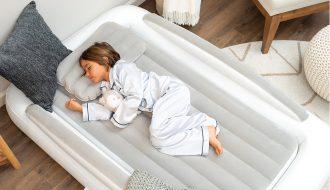 a kid sleeps on an air mattress
