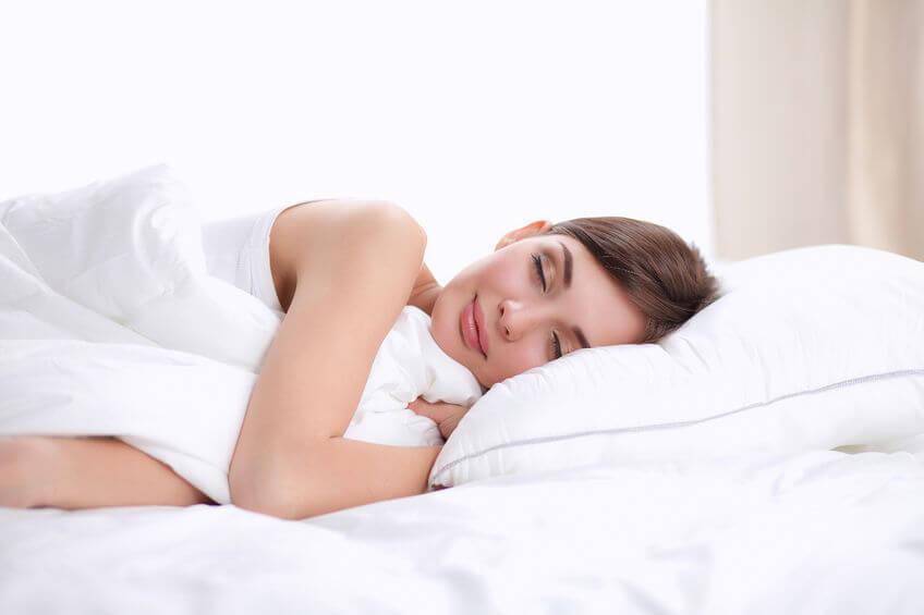 a beautiful lady lie on thin mattress