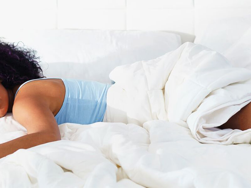 a black woman sleep with white sheets