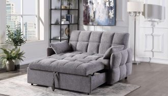a gray double sleeper chair in the living room