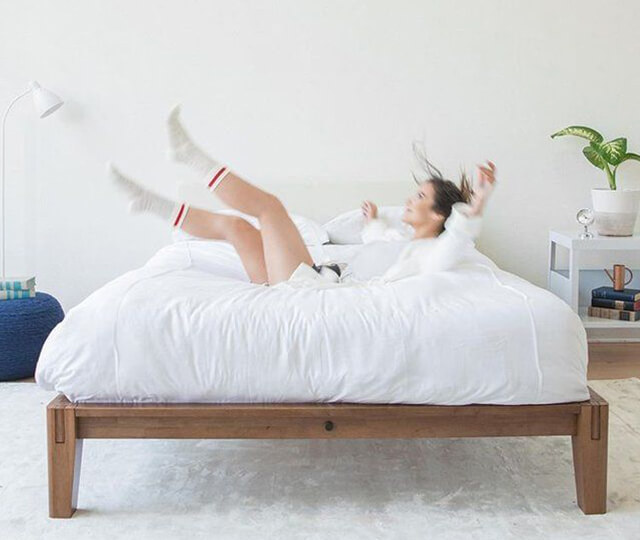 girl jump on mattress in bed frame