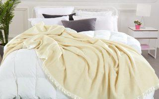 natural merino wool blanket on white bed