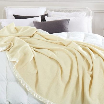natural merino wool blanket on white bed