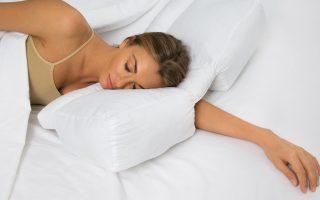 a beautiful lady sleep on wedge pillow